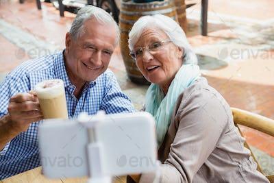 Senior couple taking selfie from mobile phone