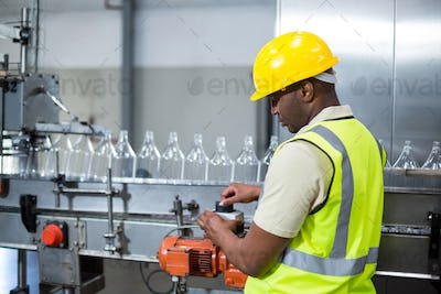 Factory worker operating machine in factory