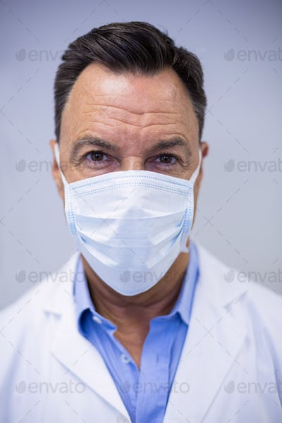 Dentist wearing surgical mask in dental clinic