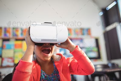 Cheerful girl using virtual reality glasses