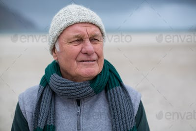 Senior man standing on the beach