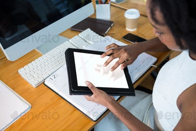 Female graphic designer using digital tablet