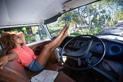 Woman relaxing in campervan