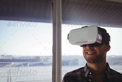 Businessman wearing virtual reality headset in office