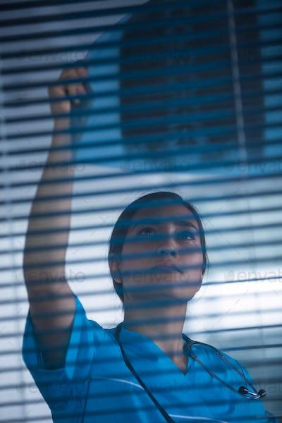 Nurse examining X-ray report