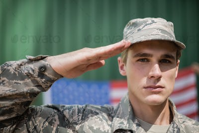 Portrait of military soldier giving salute