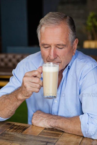 Senior man drinking cold coffee