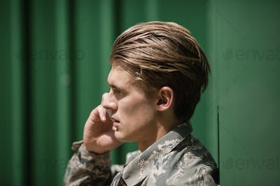 Military soldier talking on mobile phone
