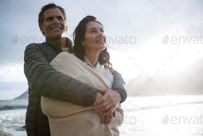 Romantic couple embracing each other on beach