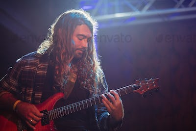 Male guitarist performing with guitar