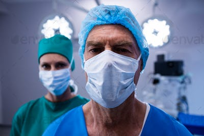 Portrait of surgeons wearing surgical mask in operation theater