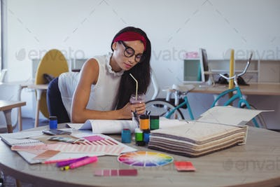Focused businesswoman working in creative office