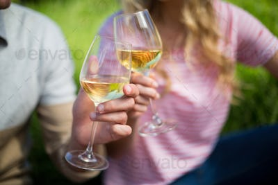 Couple toasting white wine glasses