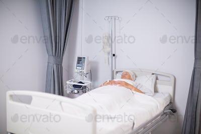 Senior woman patient sleeping on bed