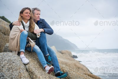 Couple sitting on rocks and enjoying the view