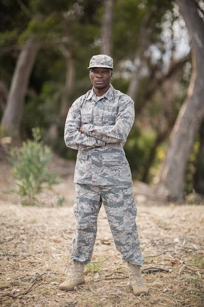 Military soldier standing with arms crossed