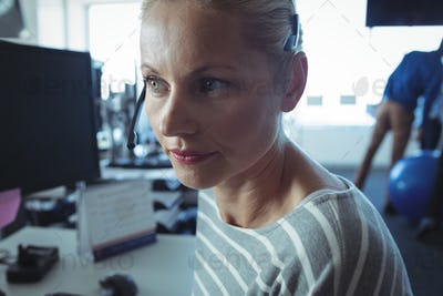 Thoughtful businesswoman at office desk