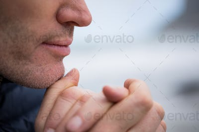 Close-up of man with hands clasped