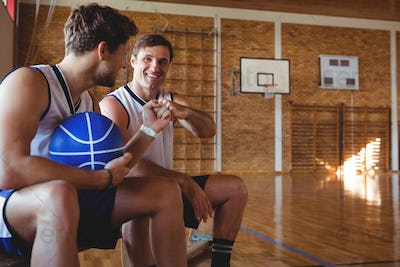 Happy basketball players doing fist bump