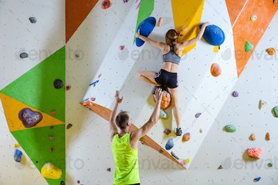 Rock climbers in climbing gym.