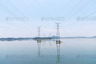 power transmission tower on water