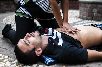 cardiac massage to an unconscious guy after injury