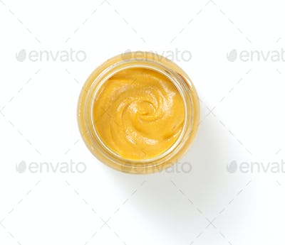 mustard sauce in plate on white background