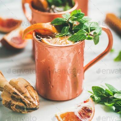 Blood orange Moscow mule alcohol cocktails, square crop