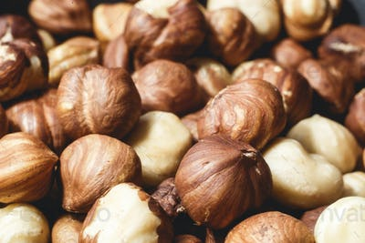 Pile of hazelnuts close-up as background