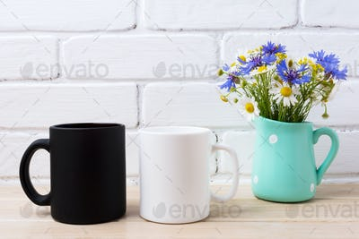 White and black mug mockup with cornflower and daisy