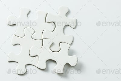 Four pieces of white jigsaw puzzle