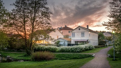 Sunset lights the houses in Molndal, suburb Gothenburg city, Swe