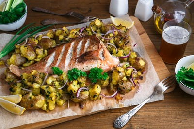 Baked sea perch or red grouper with potatoes, top view