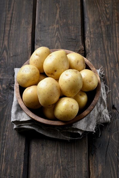 New raw potatoes in bowl