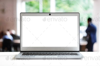 Laptop with blank screen in office