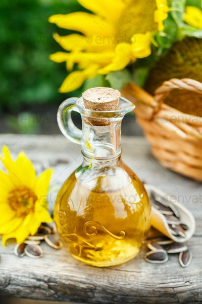 A small glass jug with fresh sunflower oil.