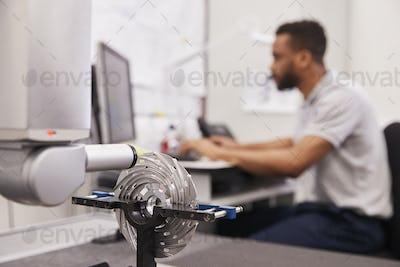 Male Engineer Uses CMM Coordinate Measuring Machine In Factory