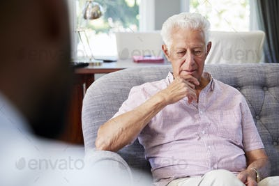 Senior man with depression having therapy with psychologist
