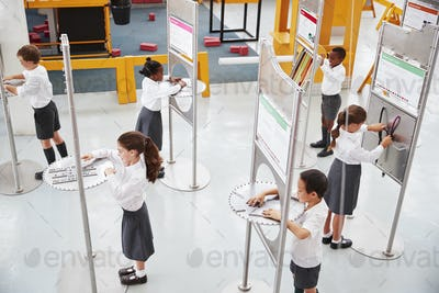 School kids doing science tests at a science centre