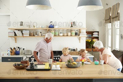 Grandparents and their grandkids talking in the kitchen