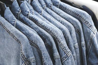 fashion jeans jacket on hangers.