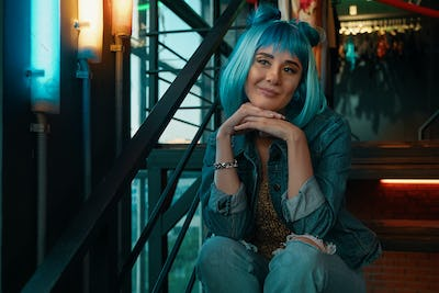 Girl portrait with stylish blue hair and pretty face expression