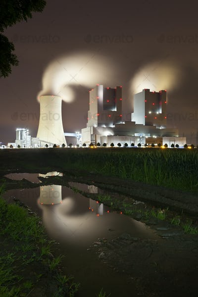 Power Station With Reflection At Night