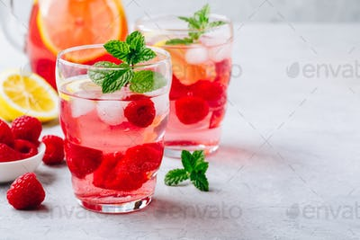 Cold drink Raspberry Lemonade with mint in glass.