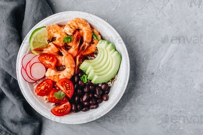 Spicy Shrimp Burrito Buddha Bowl with wild rice, tomatoes and radish, black beans and avocado