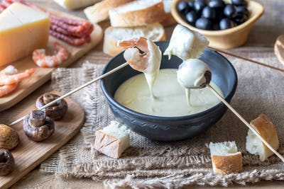 Bowl of fondue with appetizers