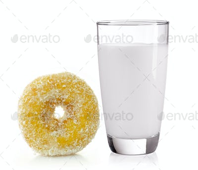 milk in the glass and donut on white background