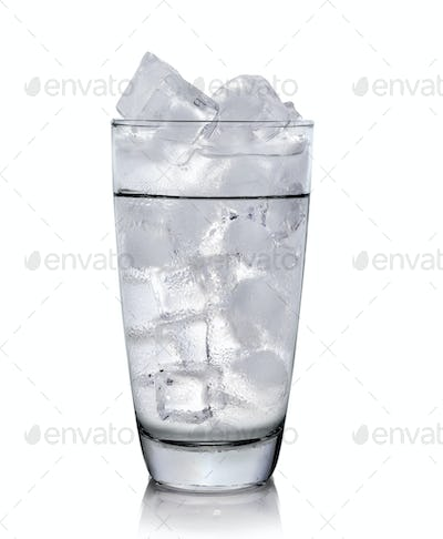 Glass with ice cubes. Isolated on white background