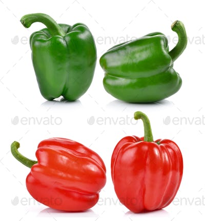 red and green pepper over white background