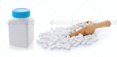 pills out of bottle on white background